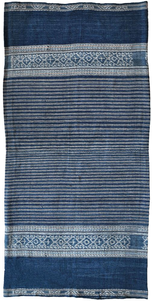 Sarong Solor Archipelago, Alor, Bird's Head Peninsula, 1920–1950. Cotton, two panels, 0.58m x 1.19m (11'1″ x 3″11″). This piece has an unusual overall colour for its type with motifs that are reminiscent of ikan pari stingray.