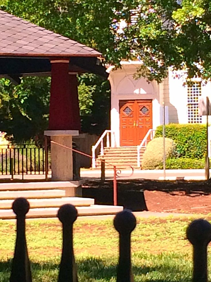 Kenwood Plaza Park American Gothic iron fence around a Heritage Oak enhancing the Community Church built in the same style.