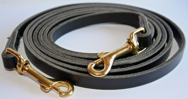 """Leather reins with snap. In black with brass snap."""" Premium line"""" produced in the Netherlands."""