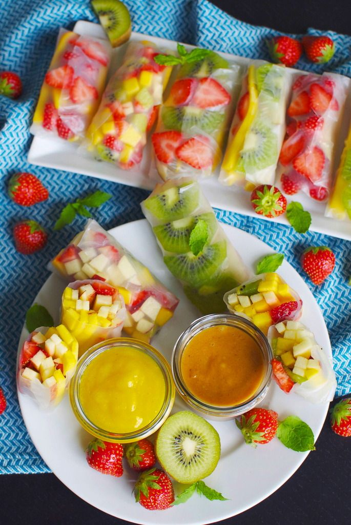 Dessert rice paper rolls with fruit and two dippings raw vegan