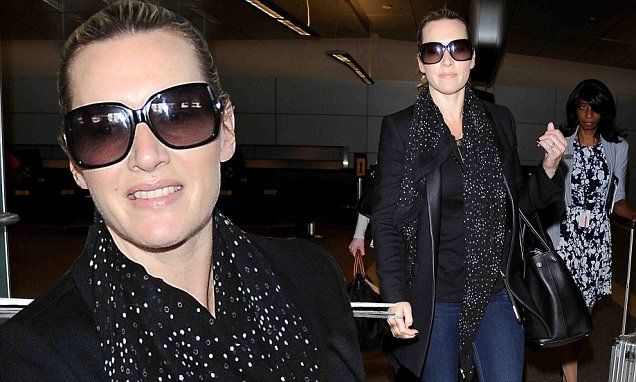Kate Winslet looks mysterious as she hides eyes behind sunglasses