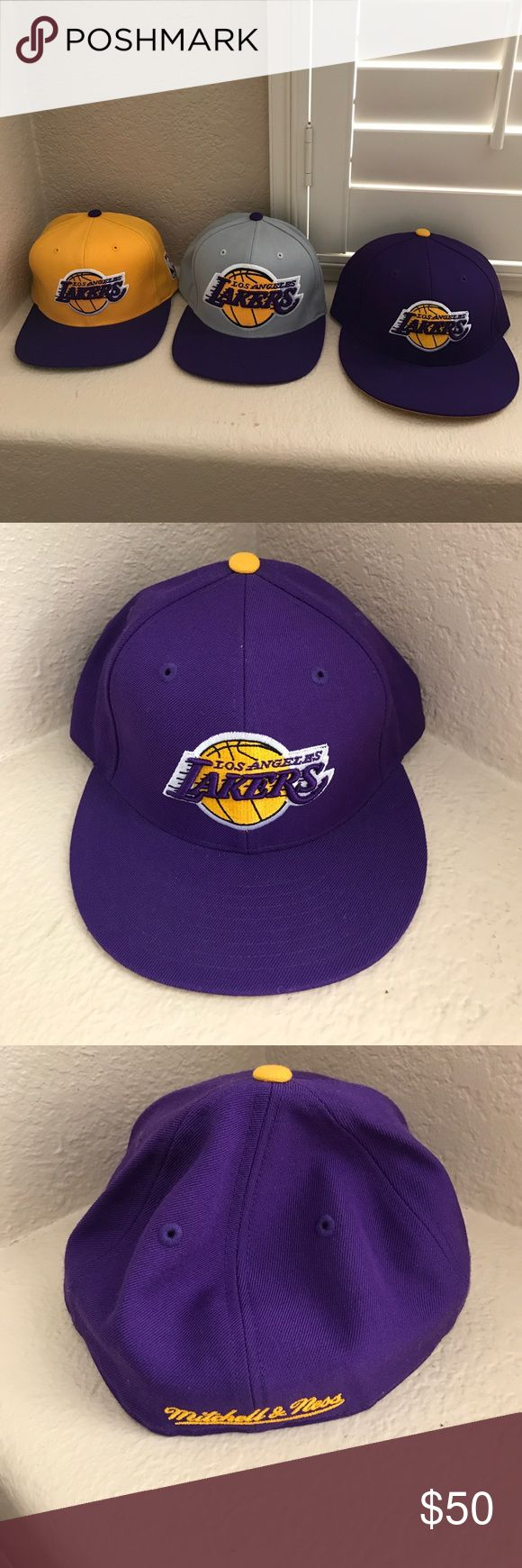 Mitchell and Ness Laker Caps Mitchell & Ness Laker Snap Back Caps and 7 & 3/8 only worn a couple of times. All three for $45 Mitchell & Ness Accessories Hats