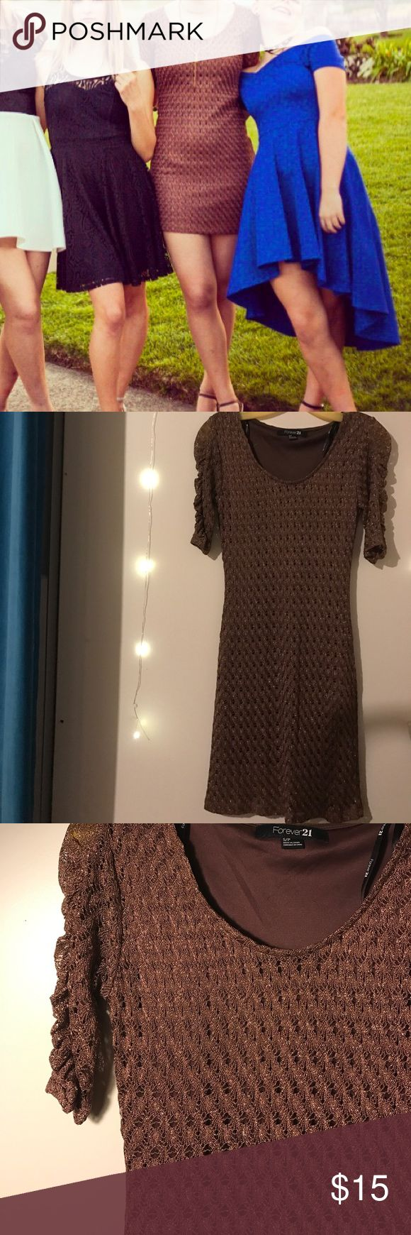 Sparkly mini dress Chocolate sparkly mini dress. Super cute, fitted and flattering, gold sparkles. Only worn once to gala. Very comfy, shows off curves. Forever 21 Dresses Mini