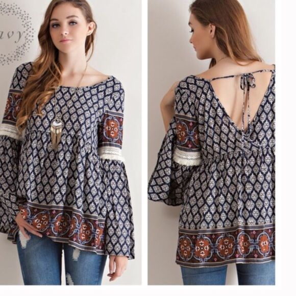 🎉SALE 🎉 Boho fringe sleeve tunic Border print peasant blouse featuring Slightly wrapped V-shape scoop back with tie-up strap detail. Crochet lace with fringe detail on sleeves. Non-sheer. Woven. Lightweight. Available in size S(2-4) M(6-8) L(10-12).  100% RAYON.  TK1425300 I am a size 10 modeling size large in first photo. 2 a T Boutique  Tops Tunics