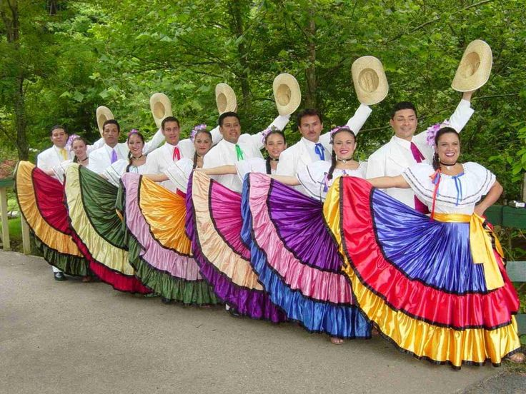 Costa Ricans has  rich culture, and  local men and women put on a show with music and dancing. In this image the women are in bright dresses and the men in white shirts with bright colored ties to match the women.