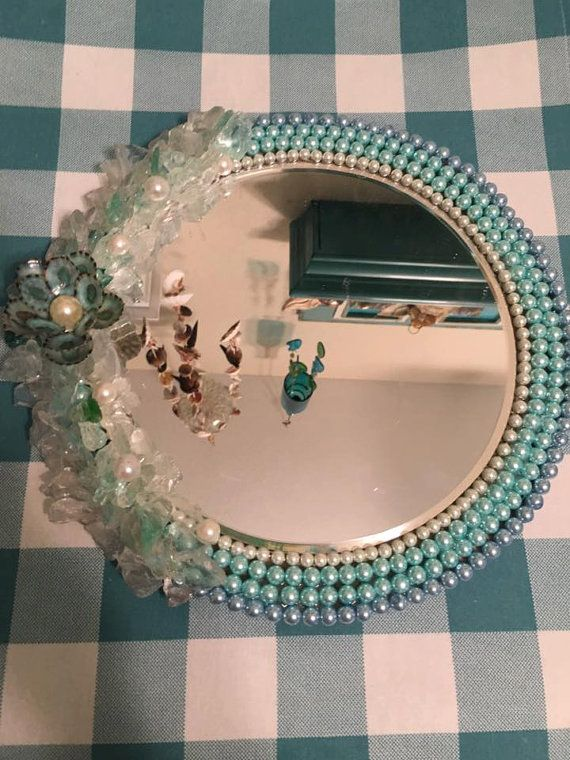 small round mirror with sea glass&white/blues/light bluegreens/with a seashell flower