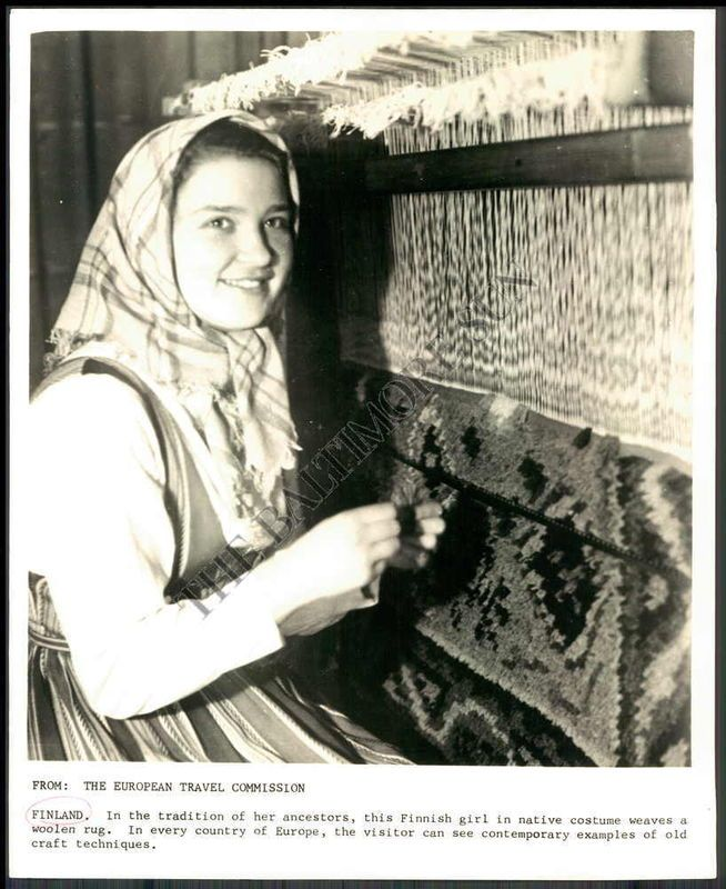 "Finnish WeaverPress photo  ""In the tradition of her ancestors, this Finnish girl in native costume weaves a woolen rug…"