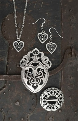 Jewelry in precious metals has been part of Norwegian culture going back to the Viking Age. The Hillestad family continues this tradition in Dølemo, Norway. This collection in pewter is drawn from the bunad jewelry of Aust Agder. $29.50
