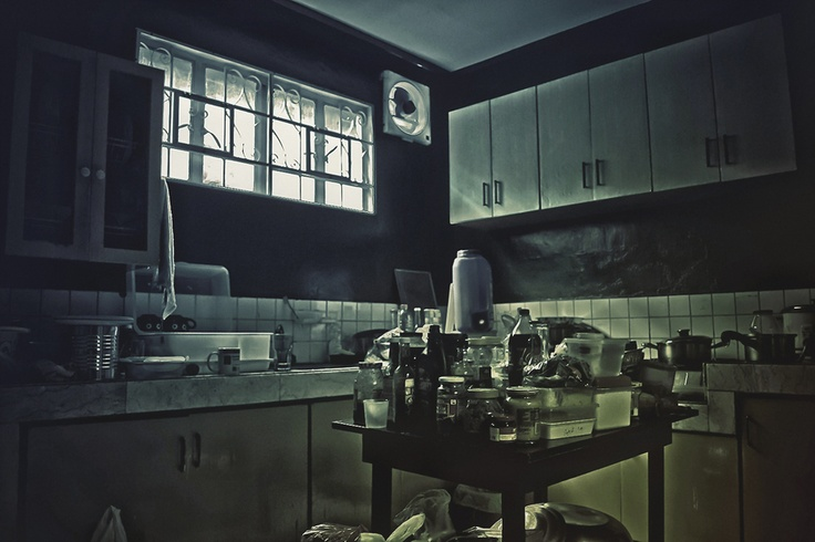 Kitchen. i like the darkness of it and the clutter. i would maybe try and achieve a bigger contrast between the light and dark.