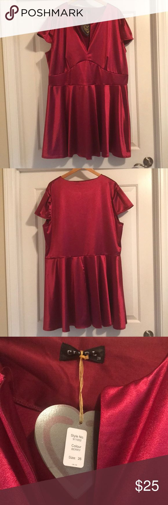 """Plus size satin skater dress This plus size satin skater dress is super comfortable. It has a v neck opening, and a large band in the front. It has some stretch, and hits around my knees (I'm 5'4"""" for reference). It by the brand Club L from ASOS. ASOS Curve Dresses"""