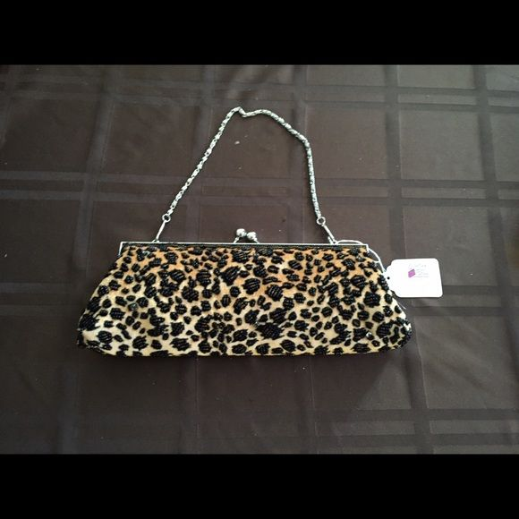 Small Leopard Purse Never used. Is sparkly, but this didn't really show upon the pictures. Cute small bag for a night out. Bags