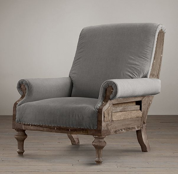 RH's Deconstructed English Club Chair:Inspired by the unadorned beauty of their grandfather's 19th-century wing chair – liberated from its velvet upholstery and the frame exposed – the Van Thiels replicated the Old World artistry in the English Club Chair. A distressed walnut frame, accented with nail tacks, is complemented by the texture of burlap and fabric. This is furniture for the ages.