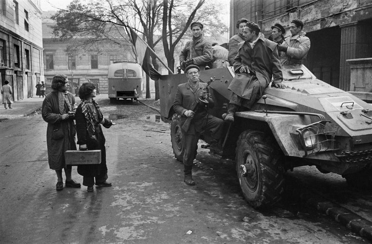 """""""A captured Soviet truck on Corvin Lane. The young rebels have decorated it with a Kossuth coat of arms, Budapest, ca. 1956."""""""