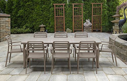 The Nardi Extendable Libeccio table with umbrella hole and 8 Costa armchairs are made for outdoor or indoor use. Made in Italy, this commercial-grade Dining set is made from 100% composite based resins (will not chip, peel or rust) and anodized aluminum for years of durability. The table's four non-slip adjustable foot levellers and the chair with non-slip feet will ensure stability. With its elegant look, this Dining collection will be a beautiful addition to any deck or patio.