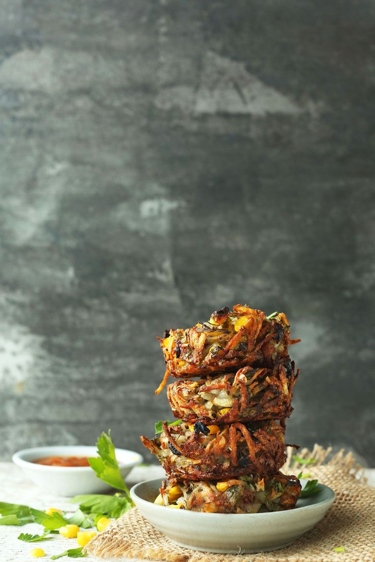 Easy crispy hash brown haystacks with corn and fresh parsley. Crunchy on the outside, slightly tender on the inside, and perfect alongside breakfast items!