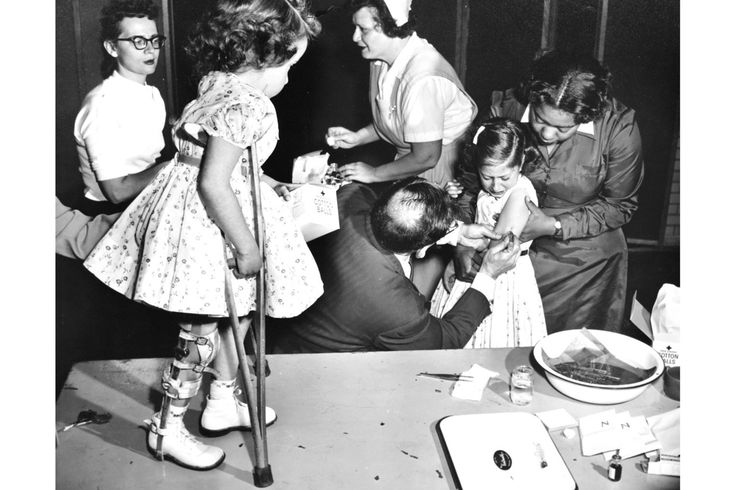 WSJ's Brief History of Epidemics - polio - Joanne Wilson, 1955 National March of Dimes Poster Girl, looks on as her friend Roslyn Feigenbaum gets a Salk anti polio shot in New York in May 1955. parents volunteered their children, almost 2 million of them, for the massive public trials in 1954 that tested Jonas Salk's polio vaccine. 4 of 10.