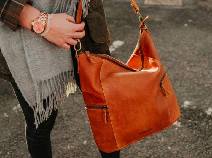 Our leather hobo bag is an iconic style that is comfortable and practical to carry while offering a classic look that will always be in style. #leatherbag #vintage #giftsforher