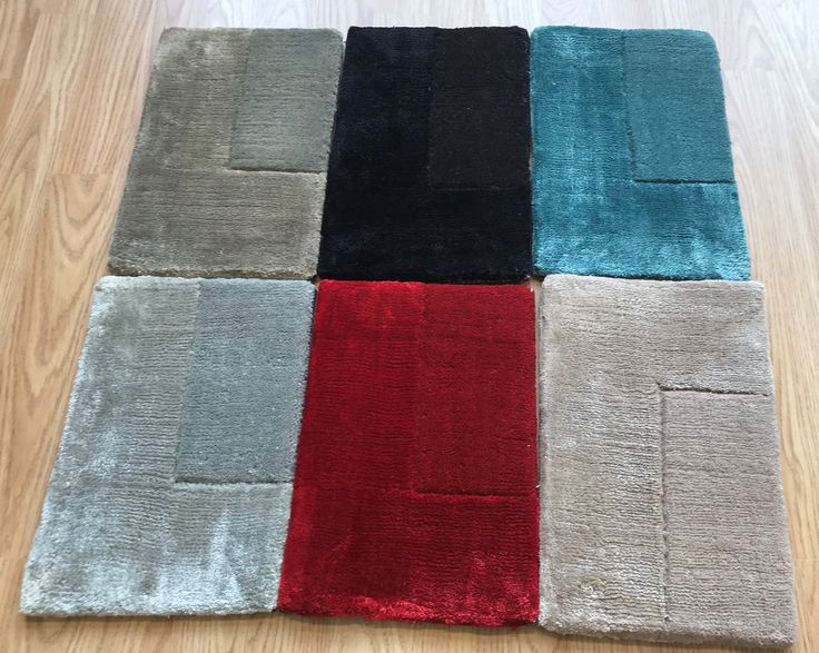 Ascot Rugs' Samples. Ascot is a range of modern hand-tufted rugs with a simple textured border design where the interior is made of wool and the border is made of super soft viscose (various colours & sizes) http://www.therugswarehouse.co.uk/modern-rugs3/ascot-rugs.html