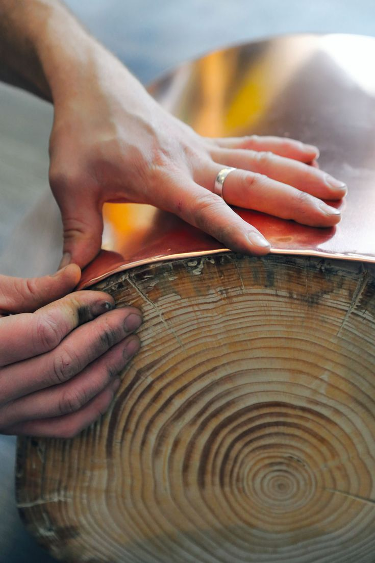 Handcrafted furniture made of wood and copper exhibits its unique rustic character