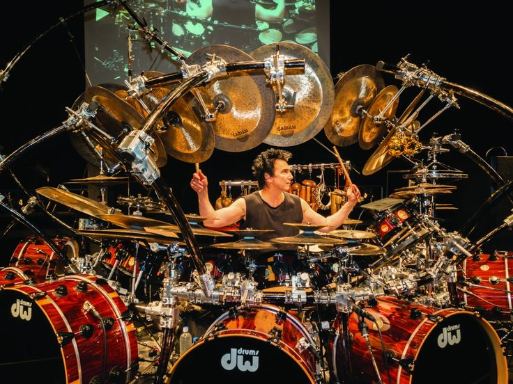 """Drum legend Terry Bozzio performs solo drum music on the world´s largest tuned drum and percussion set Terry Bozzio celebrates the 50th anniversary of his first drum lesson with """"An Evening With Terry Bozzio"""" coast-to-coast North American tour. During the course of this tour, Terry Bozzio will hit over 40 cities from San Diego to Jacksonville to Montreal to Vancouver to Los Angeles and everywhere in between. This will be a night of solo drumming and include compositions from throughout…"""
