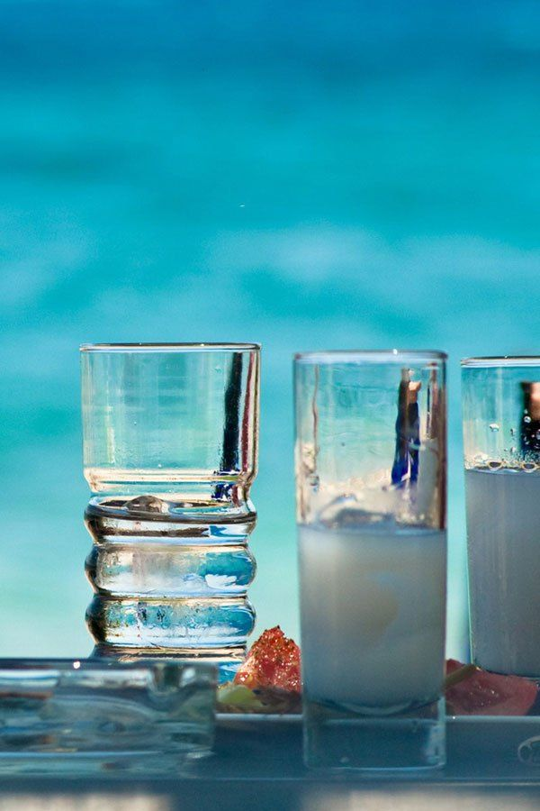 VISIT GREECE| The best-known local spirit is ouzo, a clear, anise-flavoured spirit that turns white with the addition of water. #ouzo #beverages #spirits #gastronomy