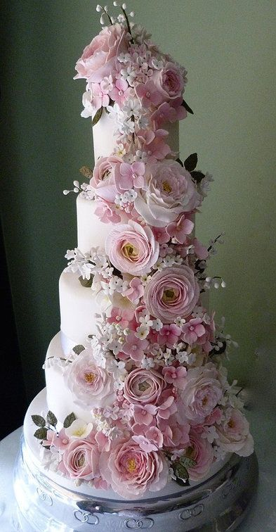 The Country Garden Wedding Cake White and pink sugar-paste garden roses, pink ranunculus, white stephanotis, lily of the valley branches and pale pink hydrangeas tumble romantically down this four-tiered wedding cake. A stylish centrepiece for any wedding reception, in the country or in town. cake decorating ideas