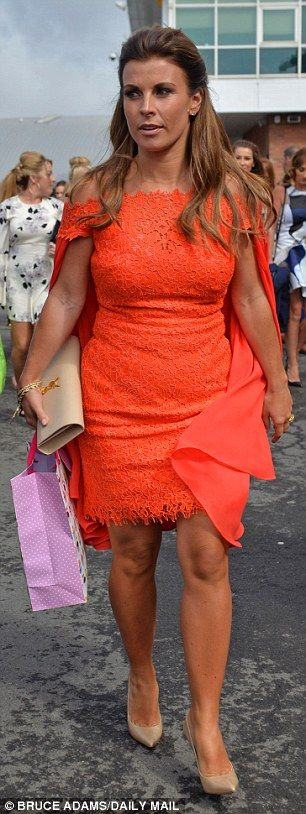 Dazzling: Coleen ensured all eyes would be on her as she walked through the crowds...