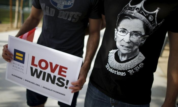 "A man wears a T-shirt showing supreme court Justice Ruth Bader Ginsburg as ""Notorious RBG."" at a celebration rally in West Hollywood  -   Photograph: Lucy Nicholson/Reuters"