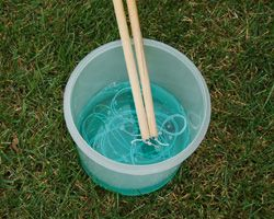 Tips & video for making & using the giant bubble-wand sticks & bubble recipe w/good tips