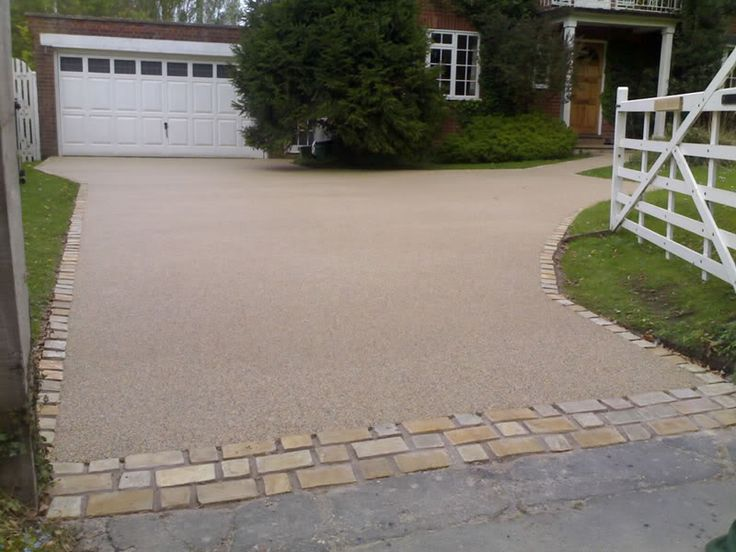 This driveway makes this cottage look even more appealing.