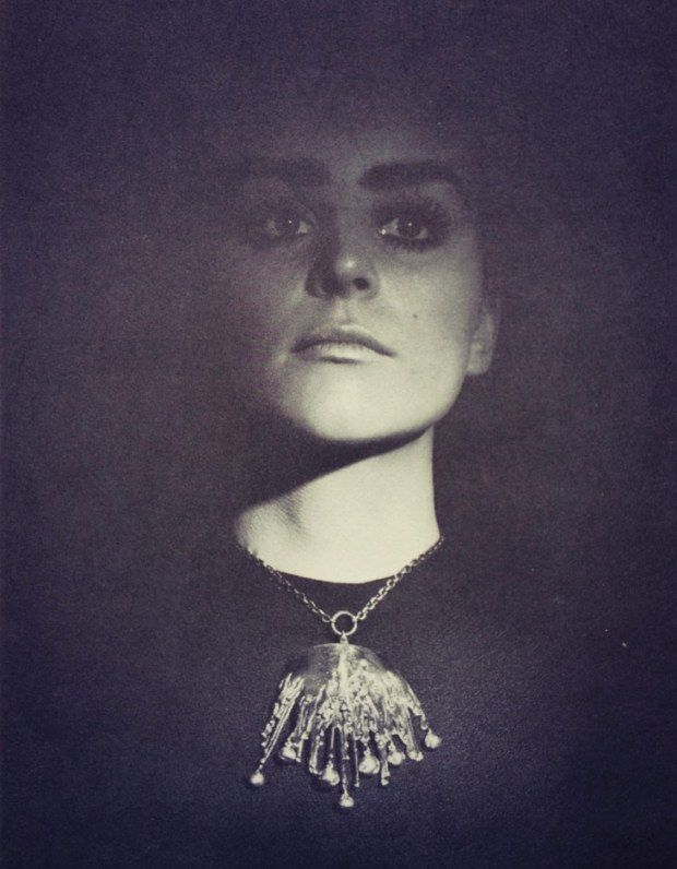 "Pentti Sarpaneva (Finland, 1925 – 1978) | A photograph from Donald J. Willcox's out of print book ""New Design in Jewelry"" of a model wearing the 'Icicles"" necklace, 1970s"