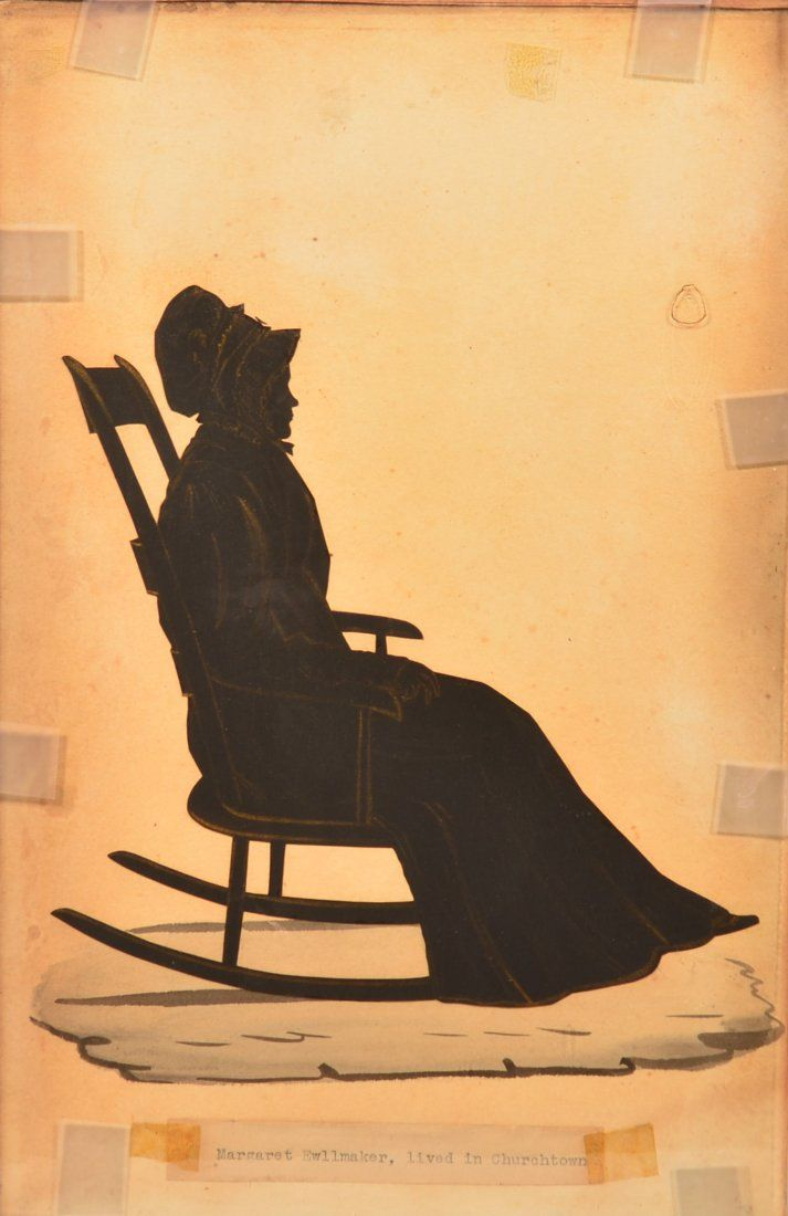 woman in a rocking chair. Painted in black with gold highlights, woman ...