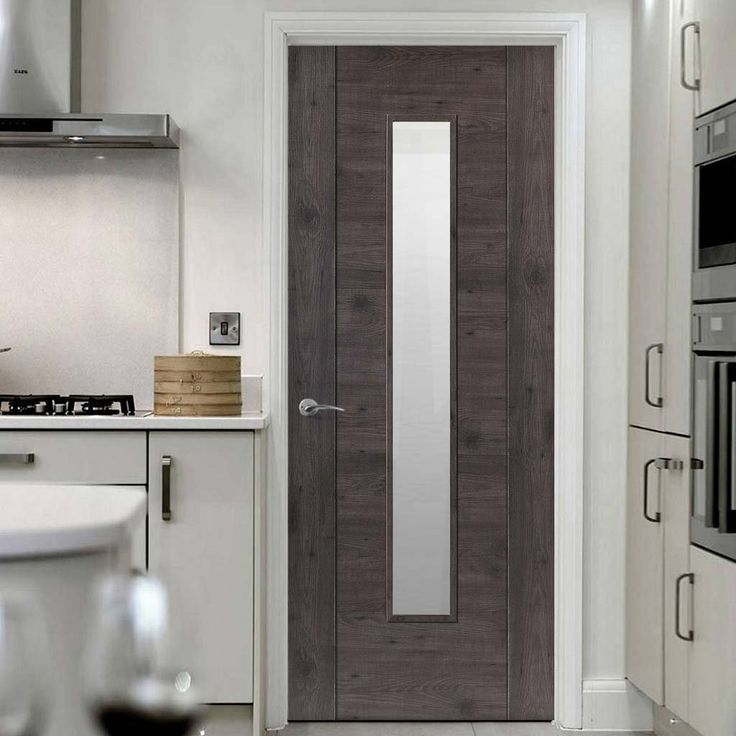 Laminates Alabama Cinza Dark Grey Coloured Door with Clear Safety Glass is Prefinished - Lifestyle Image.  #darkdoor #moderndoor