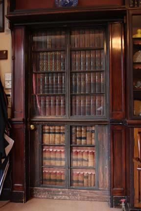 "Charles Dickens' STUDY DOOR at his Gad's Hill Place home, Higham, Rochester, Kent.  ""The door features a MOCK BOOKSHELF that...is indistinguishable from the bookshelves that line the walls."" He invented some amusing TITLES for his FAUX BOOKS [such as] Cat's Lives - 9 vol set; Socrates on Wedlock; The Wisdom of Our Ancestors series: 1-Ignorance, 2-Superstition, 3-The Block, 4-The Stake, 5-The Rack, 6-Dirt & 7-Disease; next to a thin vol. of The Virtues of Our Ancestors :-)"