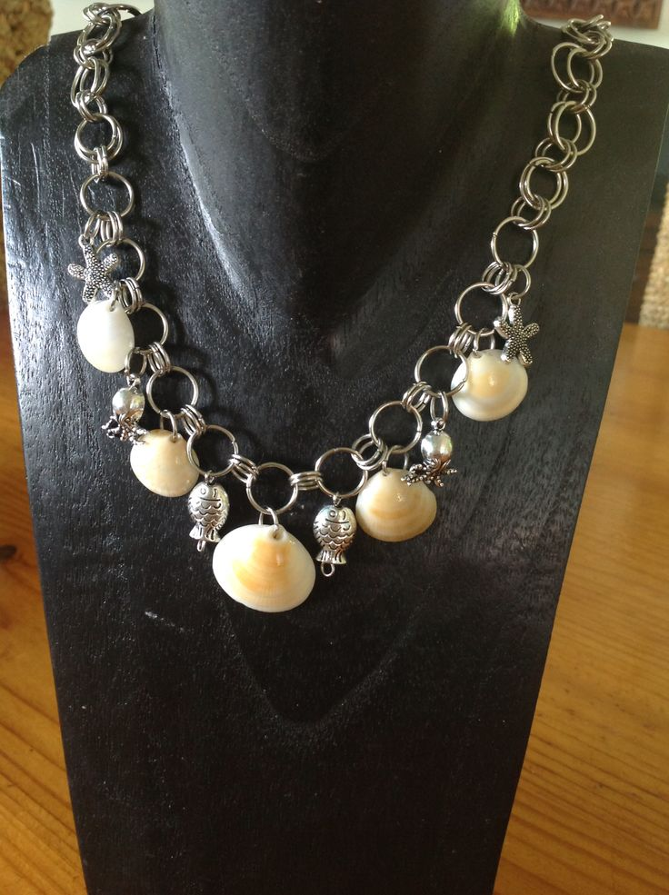 Locally sourced seashells on a handmade chain with starfish, octopus and fish charms.