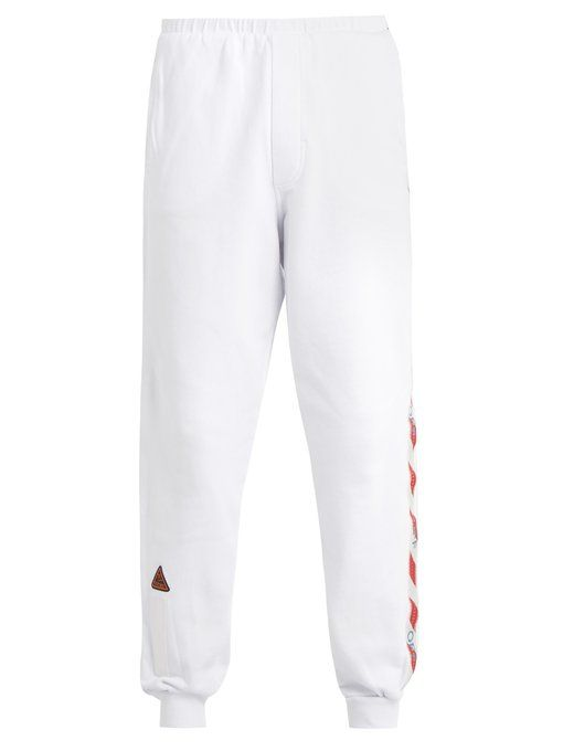 7c00671026c9 OFF-WHITE Tape-trimmed cotton track pants.  off-white  cloth