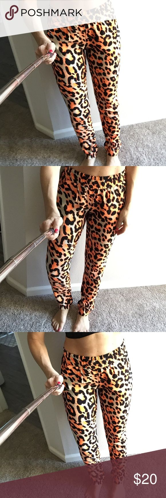 "Mika & Gala Orange leopard print pant size Medium So cute and unique! Slim, relaxed fit. size medium, true to size. 2"" Thick elastic waist band and side slit pockets. About 40"" long from top to bottom- ""fake"" butt pockets. Awesome bright Orange black and tan leopard print.  Purchased at a boutique in LA, in perfect condition no stains no rips no tears! Pants"