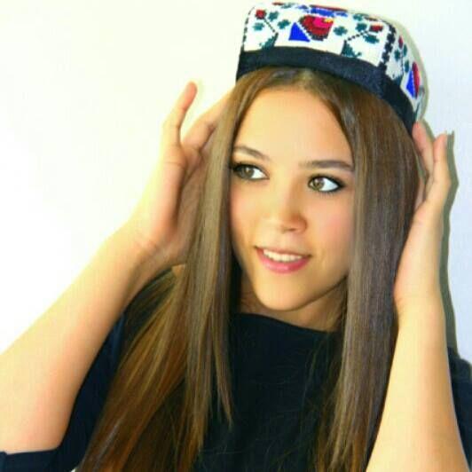 "Uzbekistan girls, traditional head wear ""duppi"". The model Nargiza Abduganievna"