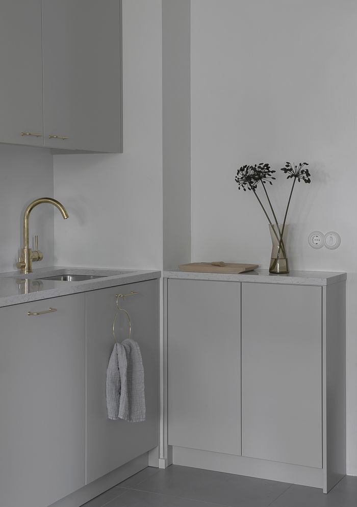 Minna Jones: Light grey kitchen ____ with brass details