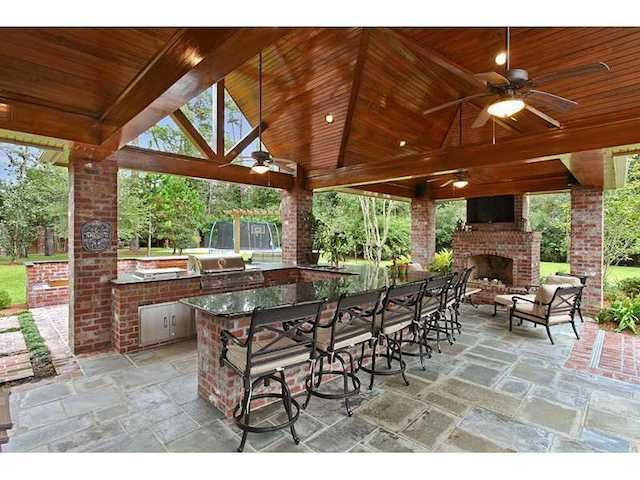 11 Ultimate Outdoor Kitchens in Multi Million Dollar Homes photo