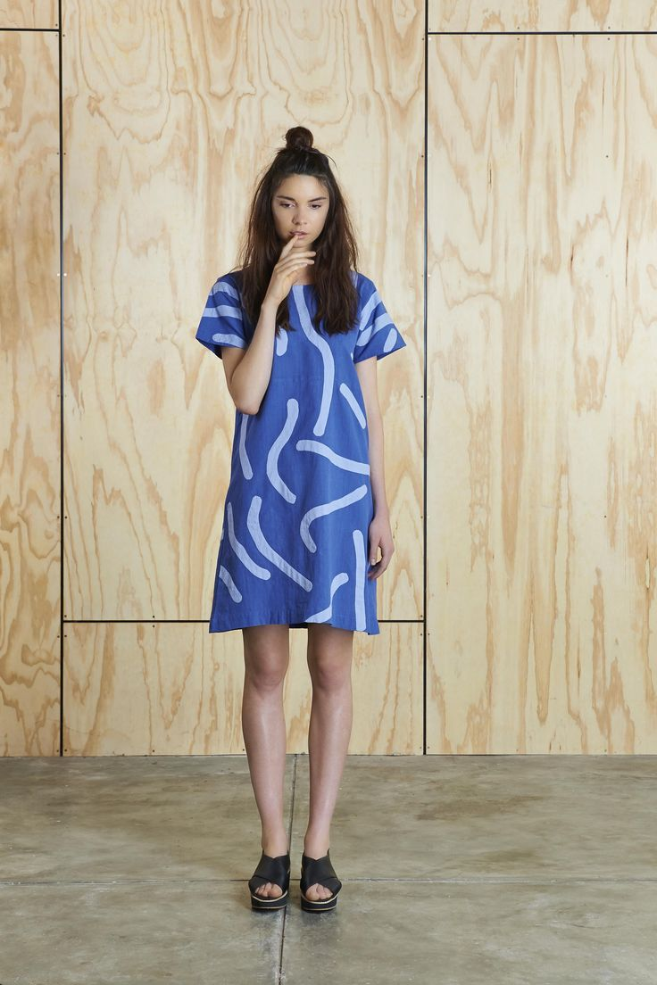 - Free worldwide shipping for orders over $100! - Hand-loomed cotton dress in reflex blue with intricately stitched light violet blue appliqué to...