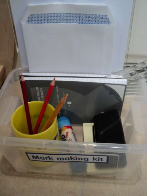 Make up mark making tool boxes to encourage writing in different areas of the room