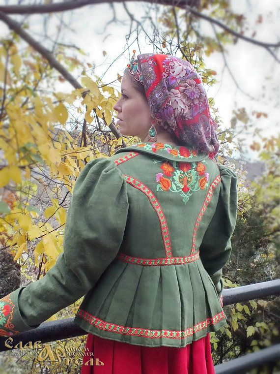 Doushegreya (short coat-jacket) Lubavushka is made of natural Belarusian linen fabric. Linen fabric is strengthened with dublerin. Also there is a warmed quilted lining on the sintepon. The collar is insulated. On the sintepon. Clasp - buttons. Embroidery copies ancient Russian floral textile patterns. Looks rich on the collar. Also there is an embroidery on the cuffs of sleeves, at the bottom corners of the shelves and on the back. The braid is made of natural linen with embroidered pattern…