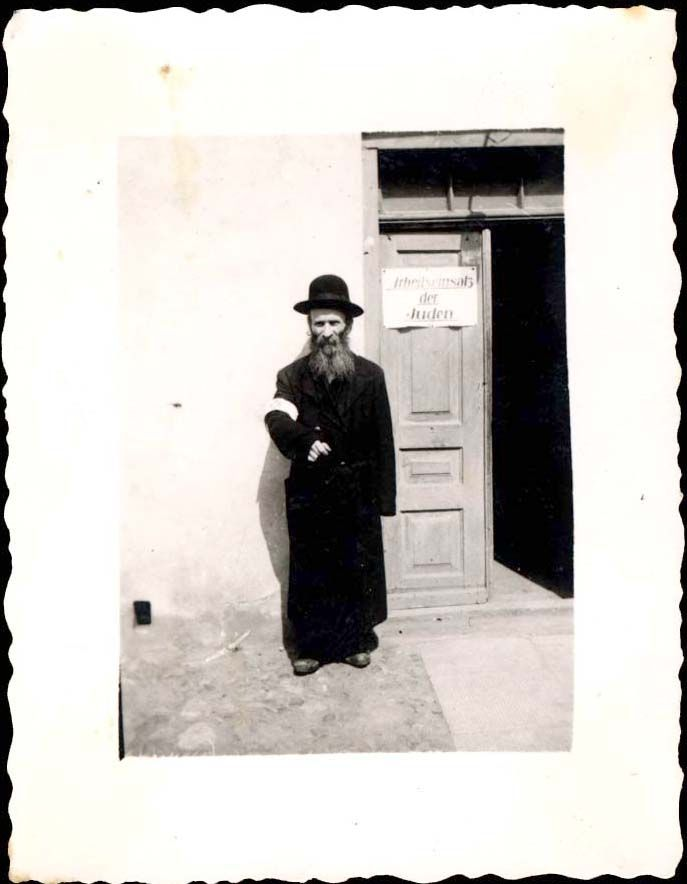 Lukow, Poland, 1940, A Jew in front of the entrance to the Judenrat offices