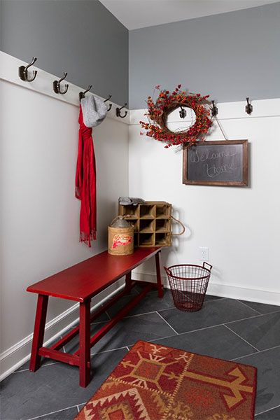 Top wainscoting with handsome wall hooks and play up rustic accents to provide a sturdy place to hang hefty items. This corner was built by Anchor Builders.