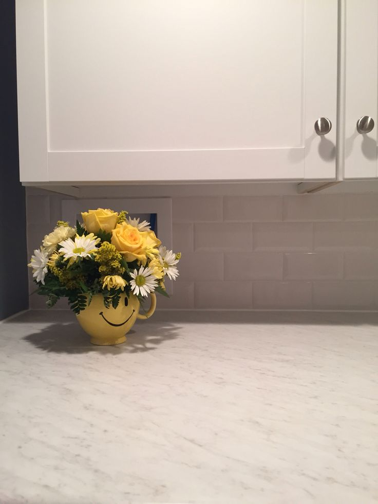 In the laundry room I picked WilsonArt laminate countertops that look like Carrara marble ($250 installed) and snow white beveled subway tile (29¢ per tile) for the backsplash. Both from Home Depot.