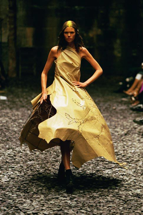 Alexander McQueen -   Ensemble:   Eshu, autumn/winter 2000–2001.   Dress of beige leather; crinoline of metal wire.