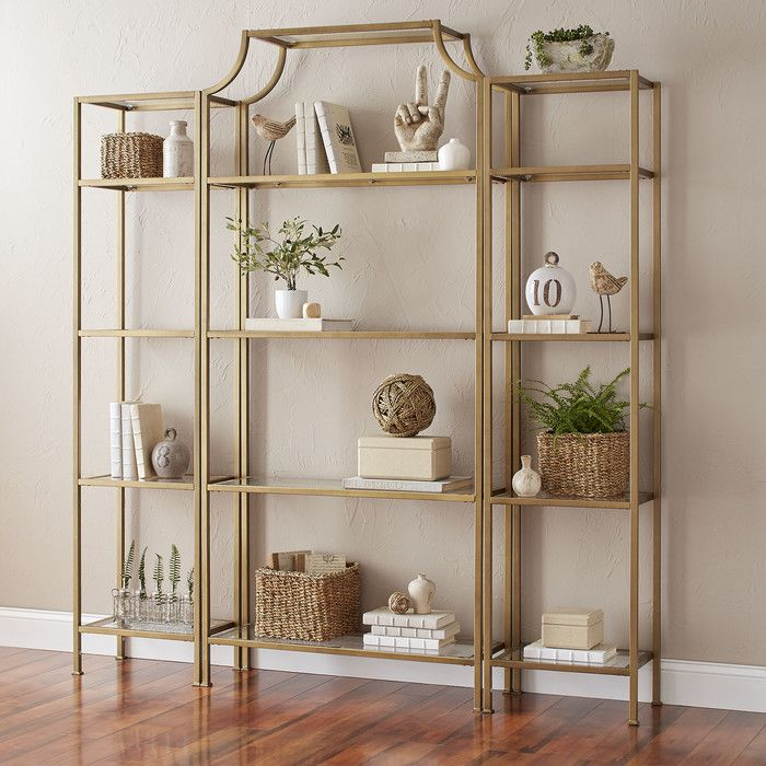 Simply chic, this gold-hued etagere looks equally stylish displaying your favorite photos and travel souvenirs in the living room or holding colorful pans and copper pots in the kitchen.