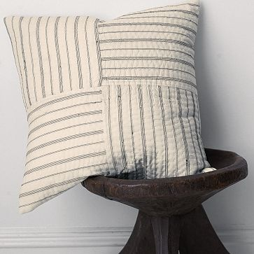 I really love those pillows where all of the stripes meet to look like concentric squares, but this is another cool idea.