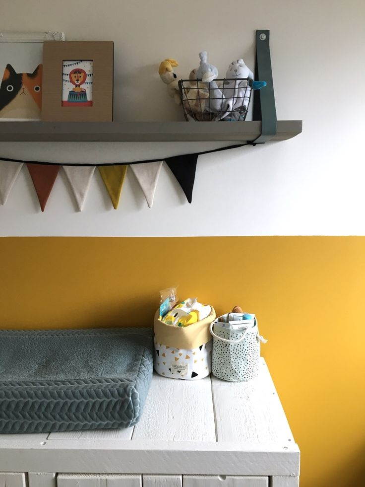 Changing table with ochre background. Boysroom